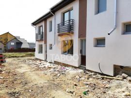 De casa cu 3 camere loc de parcare si curte proprie in Sibi