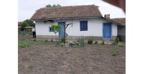 Casă țărănească cu 1209 mp teren intravilan în Sohatu - Călă