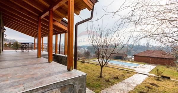 O proprietate deosebita cu vedere la lac si piscina!