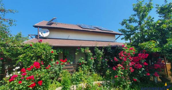 Casa cocheta, imbratisata de natura, la poalele Lempesului